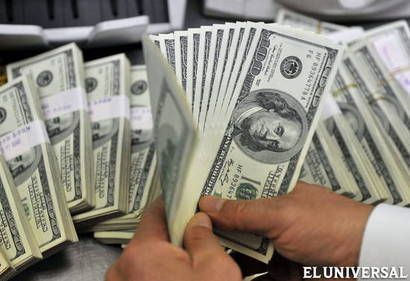 Devaluación elevó a Bs 14,9 el tipo de cambio promedio (22/06/14)