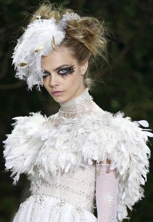 Messy do in a futuristic gothic style. Add dramatic hair accessories to accentuate more chaotic yet beautiful result