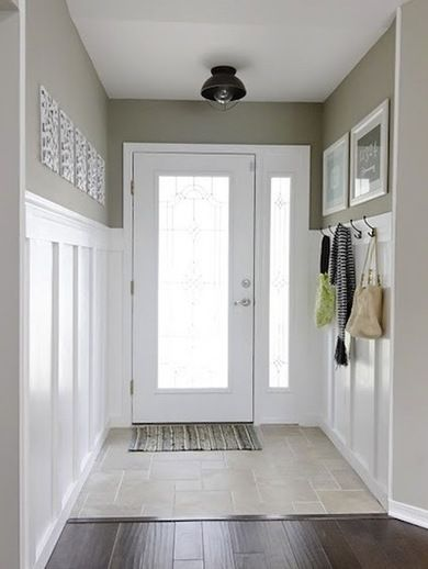 Clean and crisp entryway.  Like the hooks for purses on top part of wainscoting