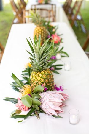 Protea & pineapple table decor: http://www.stylemepretty.com/destination-weddings/2015/08/26/tropical-colorful-wedding-in-kauai-botanical-garden/ | Photography: Heather Cook Elliott - http://heathercookelliott.com/