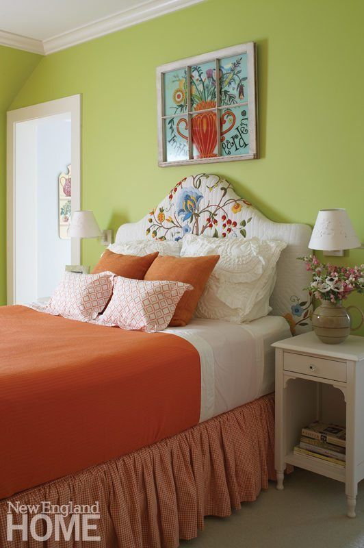 a quilted upholstered headboard creates a colorful focal point