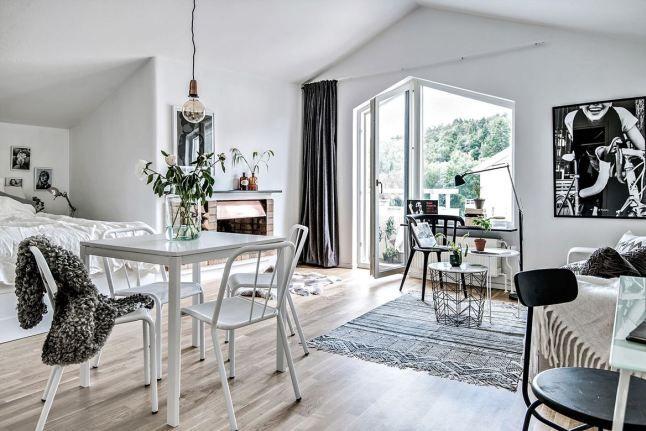 Garsonieră cu șemineu într-o mansardă din Suedia Jurnal de design interior