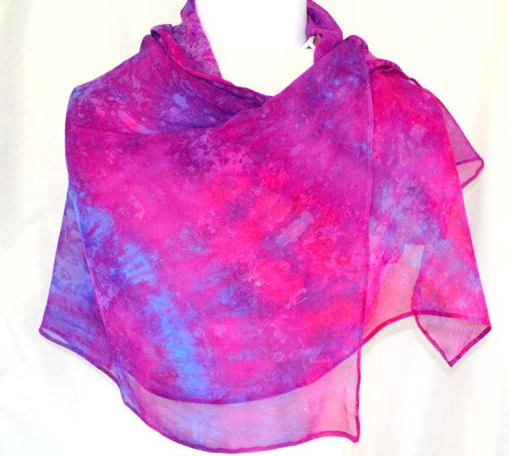 This hand dyed Silk Gauze Wrap is lovely in a subtle mix of pink and turquoise. It measures 66 inches x 19 inches (157 x 48 cms ). It is a fine soft silk that can be used as a scarf for day wear or a wrap to take you out in the evening .  Silk is surprisingly easy to care for. It is a hand dyed product so hand wash separately in cool water with a gentle detergent. Hand wring and line dry in shade. Simply warm to hot iron the back of the scarf and youre done ! See more of my silk scarves and…