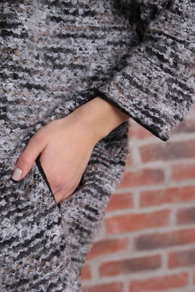 Bracelet length sleeve, open front sweater coat. Marled knit in neutrals. Thin leatherette accent bands around wrists and down length of spine. Looks amazing over a LBD and accessorized with Tokyo Jane bangles and bracelets
