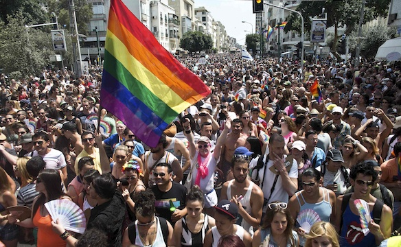 People take part at the annual Gay Pride parade in Tel Aviv