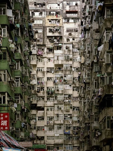 Kowloon Walled City in China. Leveled in 1994. Such a place would make a fantastic setting for a haunted horror novel or dystopian sci-fi novel!