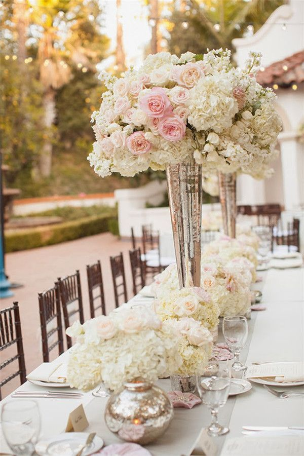 20 Truly Amazing Tall Wedding Centerpiece Ideas | http://www.deerpearlflowers.com/20-truly-amazing-tall-wedding-centerpiece-ideas/