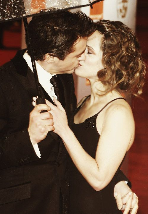 Robert Downey Jr. and Susan Downey - romance in the rain.