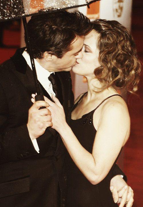 Robert Downey Jr. and Susan Downey - romance in the rain.