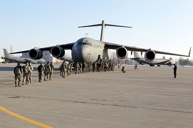 Airmen from the 127th Wing board a C-17 Globemaster at Selfridge Air National Guard Base, Mich., on Friday, January 23, as they head to Davis-Monthan AFB, Ariz. for Operation Snowbird. Approximately 200 Michigan Airmen will deploy for the annual training in warmer weather and optimal training conditions. The C-17 is from the 154th Wing, Hawaii Air National Guard. (U.S. Air National Guard photo by Tech. Sgt. Dan Heaton)