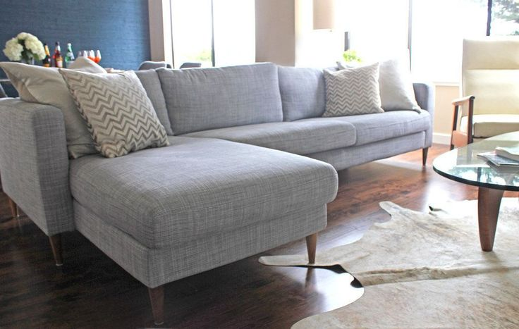 Annie and her husband first decorated her living room with a Karlstad sectional couch that came with classic Ikea birch legs.