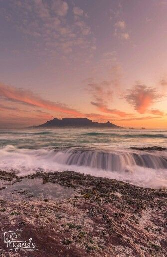 Sunset at Bloubergstrand, Cape Town. Table Mountain in the background.