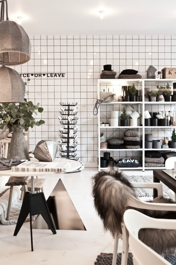Nordic colors in grey, white, black and tree shaded colors with dusty green plants. lotta agaton