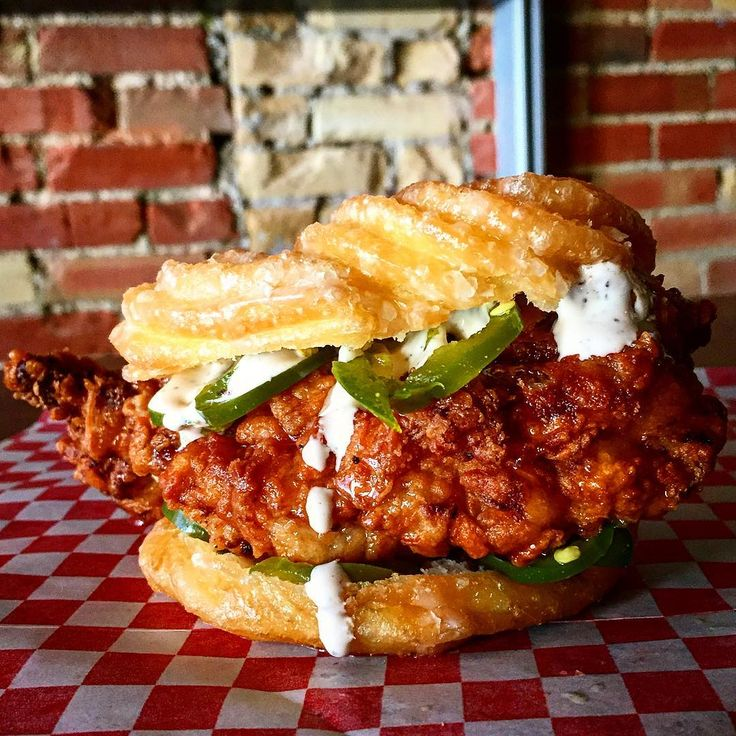 Sweet & Spicy Fried Chicken - I cooked chicken strips with BBQ sauce on top then layered onions, fresh jalapeños, chicken, ranch, lettuce on a donut. Delicious!