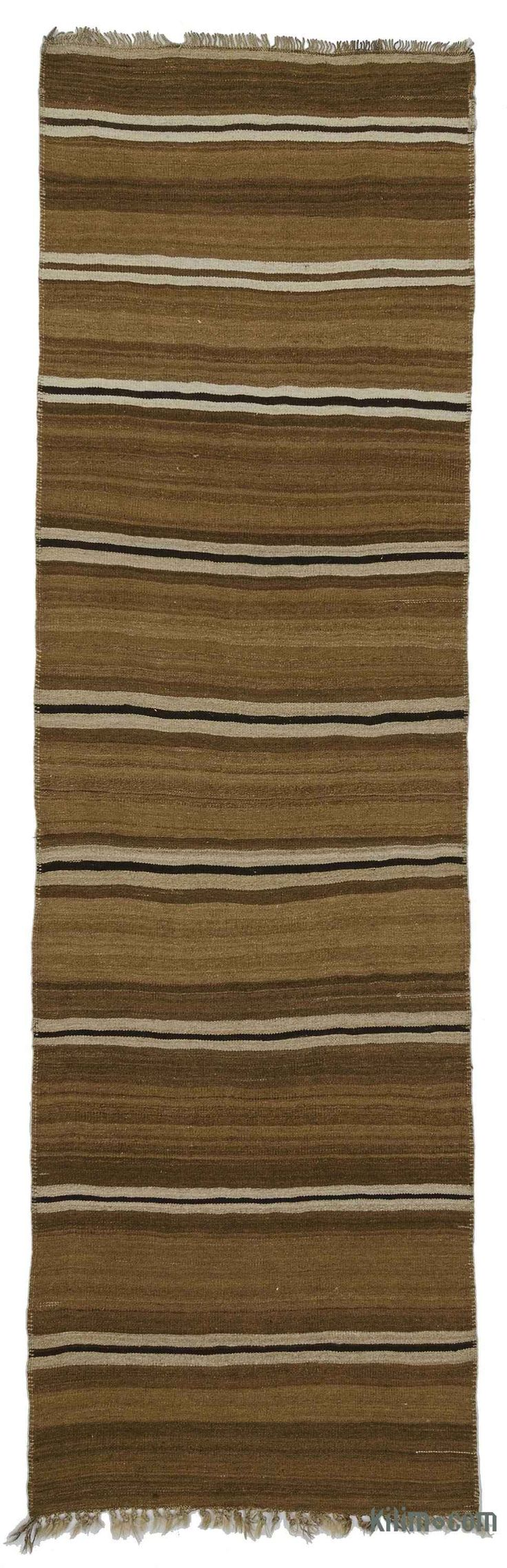 Vintage kilim runner rug handwoven in Turkey in 1960's. This tribal striped rug is in very good condition. It is perfect for both bohemian and contemporary settings.