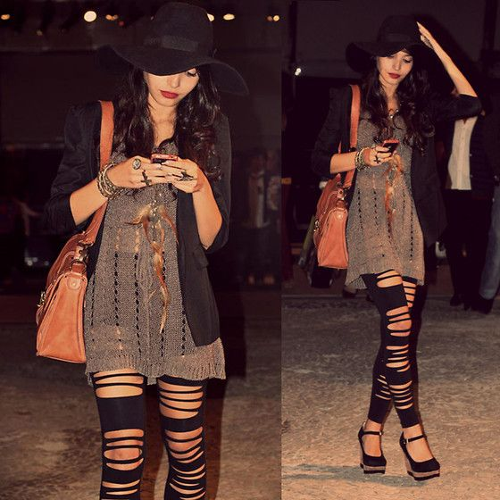 sheer sweater over ripped leggings with satchel and floppy hat.  rough, but put together