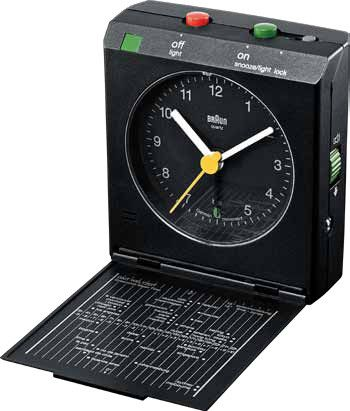 """Features:  -Braun quartz movement.  -EL Light.  -Volume control.  -Flip-down front cover.  Product Type: -Radio clock.  Time Display: -Digital. Dimensions:  Overall Height - Top to Bottom: -3"""".  Overa"""