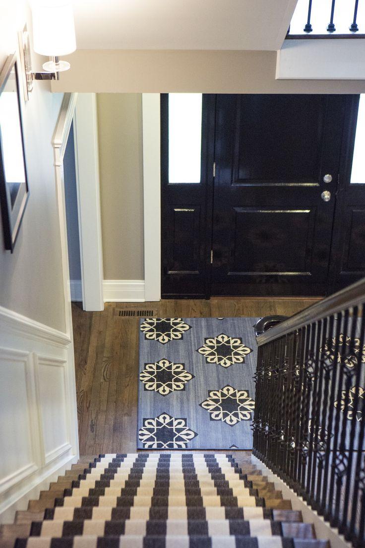 alexandra kaehler design striped runner with madeline weinrib rug and black lacquer front door