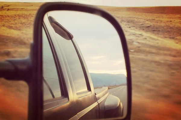 Jack Dusty Clothing & Lifestyle blog - Wing mirror reflection of the car and the road on a sunny evening