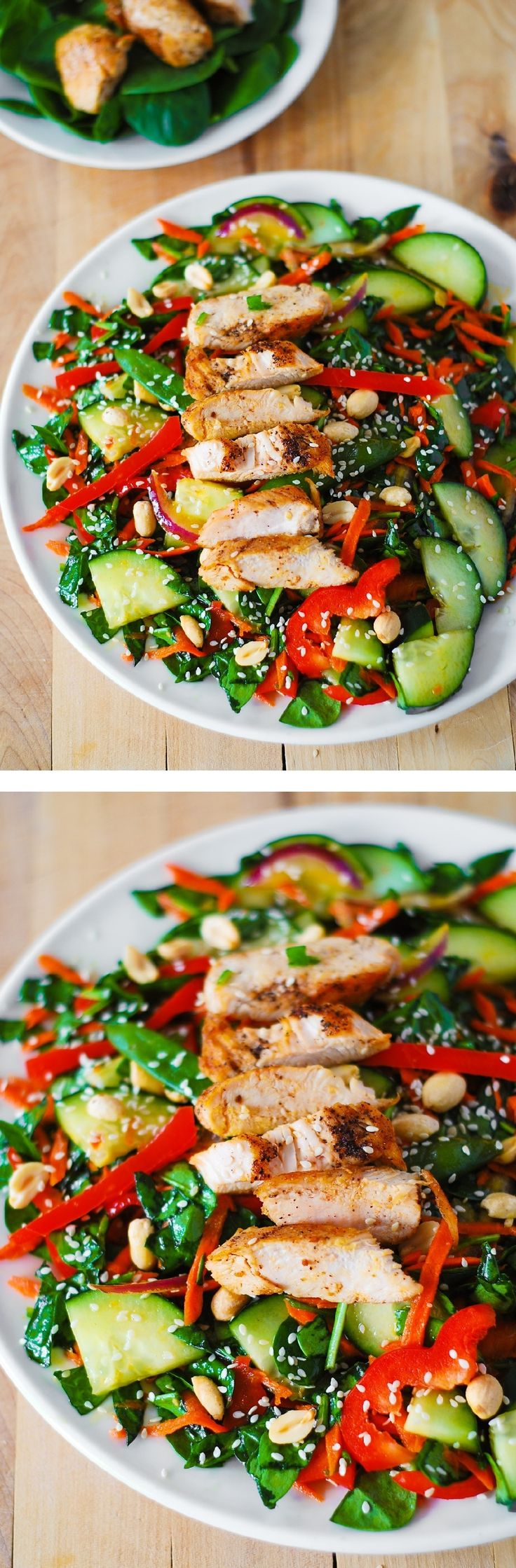 Crunchy Asian Salad with Chicken and homemade Sesame Peanut Dressing – gluten free, healthy recipe! Lots of vegetables: spinach, cucumbers, red bell pepper, carrots, sugar snap peas – all tossed in a delicious, homemade peanut dressing, topped with grilled chicken, toasted peanuts and sesame seeds.