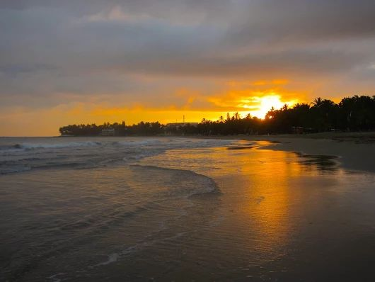 """Local photog aficianodo, James Lowe captures the calm November sunrise over the Dominican Republic's world famous Cabarete Beach....great day for the time change's """"extra"""" hour :) ~~ This is your front yard scene when you live here: www.our-dominican..."""