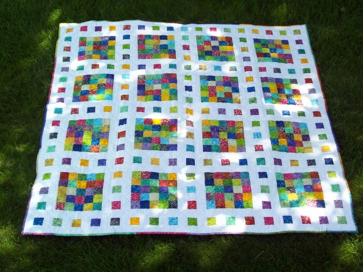 Film at Five Scrap Quilt Pattern, from www.FaveQuilts.com.   6/15 Scrap quilt design. The patchwork sashing makes each of the rows in this quilt look like a filmstrip. Customize the placement of different colors and prints to make interesting scrap quilts. You could make each block a different color, or change the sashing so that it's all in black and white. Quilt Size: 86.5 inches wide x 86.5 inches long Time to complete: A week or two Primary Technique: Pieced Difficulty Level: Easy