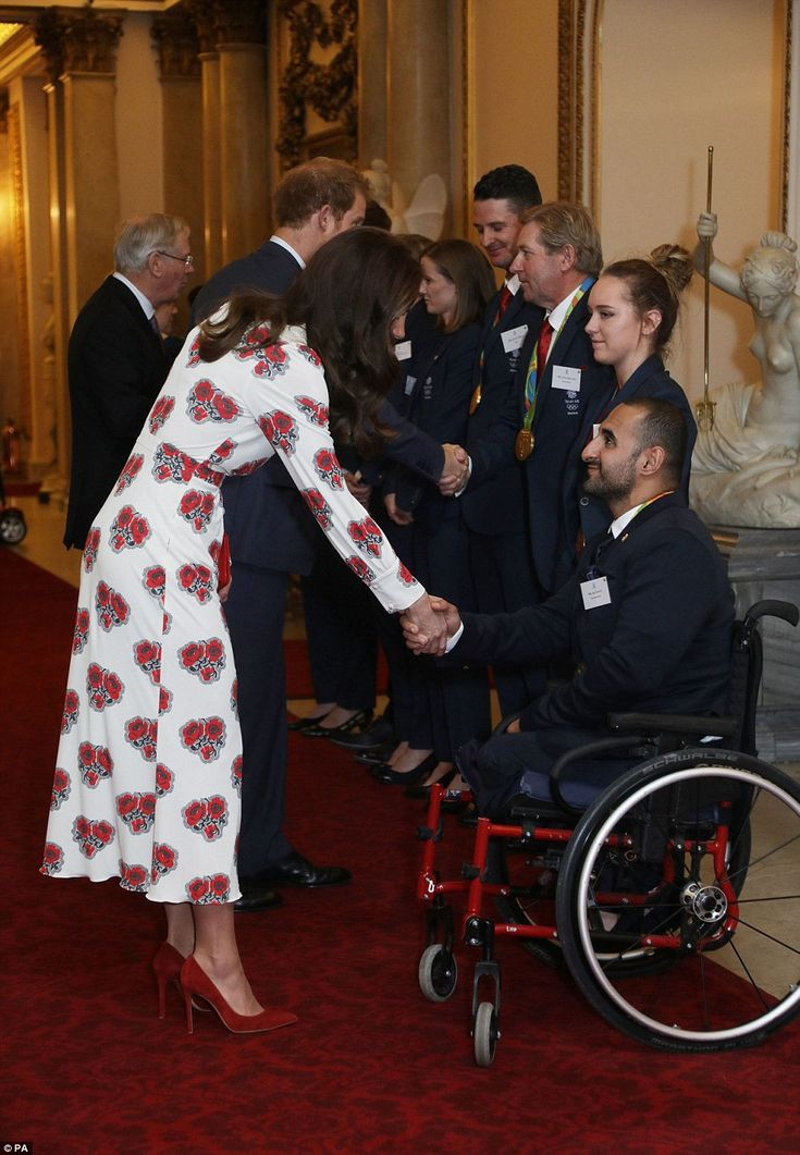 Kate donned a pair of stylish red suede heels as she hosted the event to honour the Olympic and Paralympic heroes