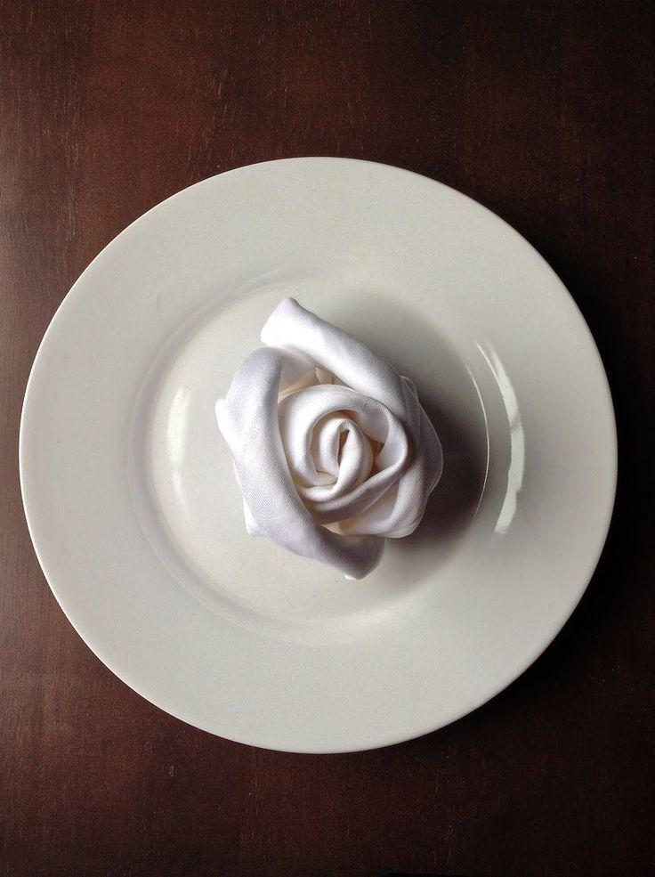 How to fold a cloth dinner napkin to create a rose bud. See more napkin folding designs at http://napkintricks.com