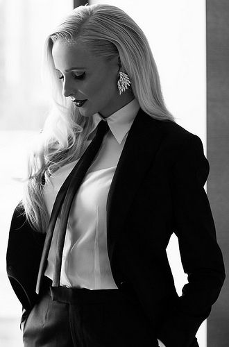 Dressed In Black Pants Suit With White Shirt And Black Tie Women