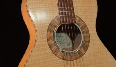 Sound hole on a curly maple Weissenborn guitar by Rich Guitars.