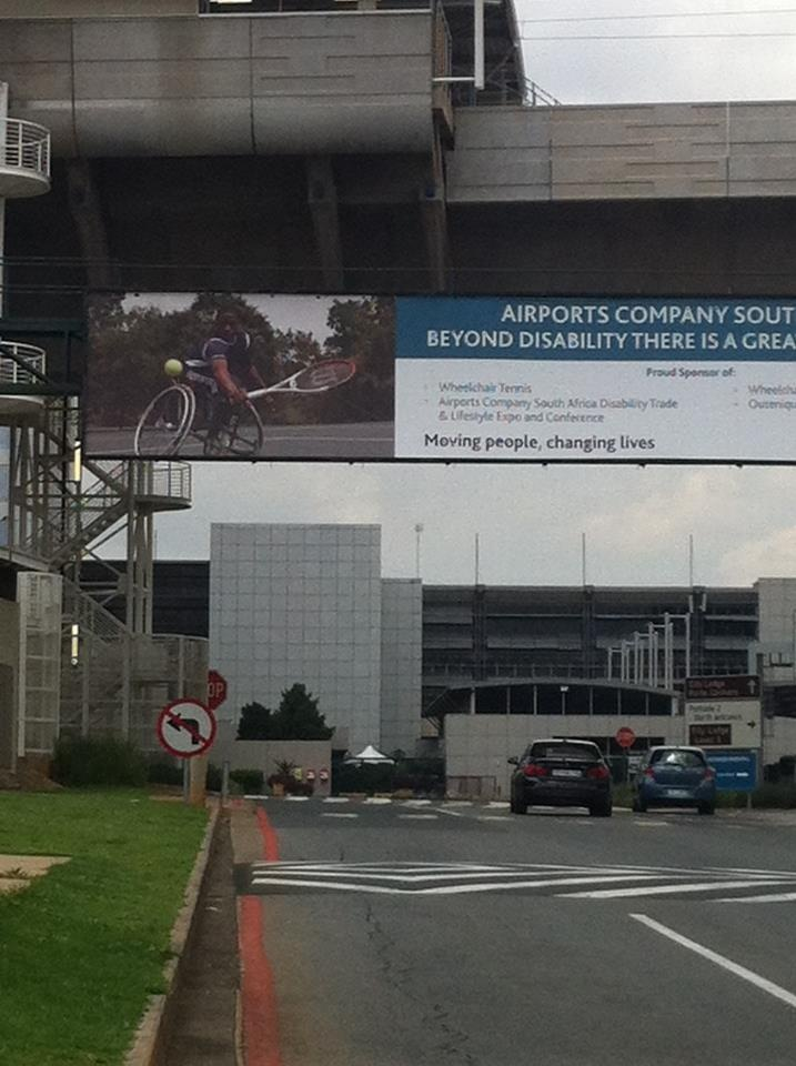 Billboard with South African wheelchair tennis Evans Maripa at Johannesburg airport.