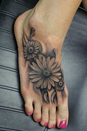 Floral Tattoo Meanings | CUSTOM TATTOO DESIGN in 2020 | Foot tattoos, White flower tattoos, Tattoos for women flowers