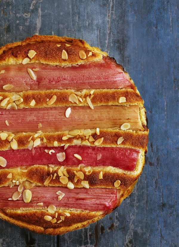 Rhubarb Bakewell tart - this is a modern twist on a British favourite made using rhubarb. It's easy to make but looks impressive. Rhubarb is in season from February until May.