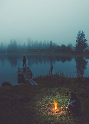 Foggy photograph of campers by a lake that has a mysterious yet magical feel to it. Available as poster and laminated picture at printler.com, the marketplace for photo art.