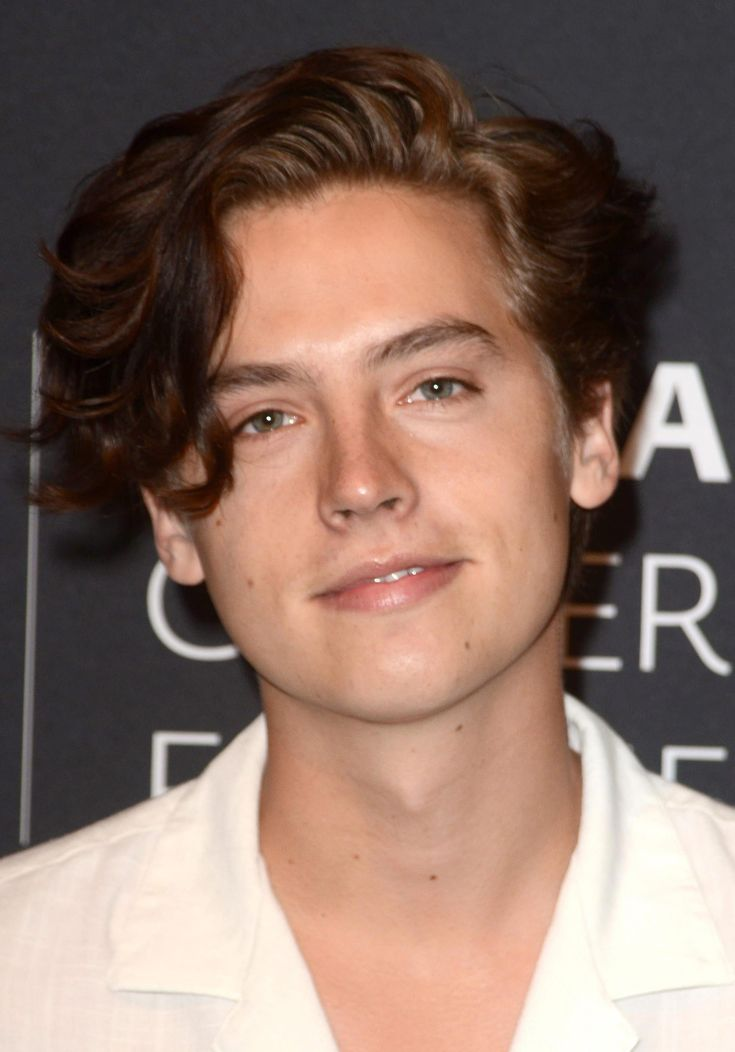 Cole Sprouse's Scissor Cut with Side Swept Fringe - Here's a more artsy type of haircut that features a large side swept fringe. A scissor cut is us...