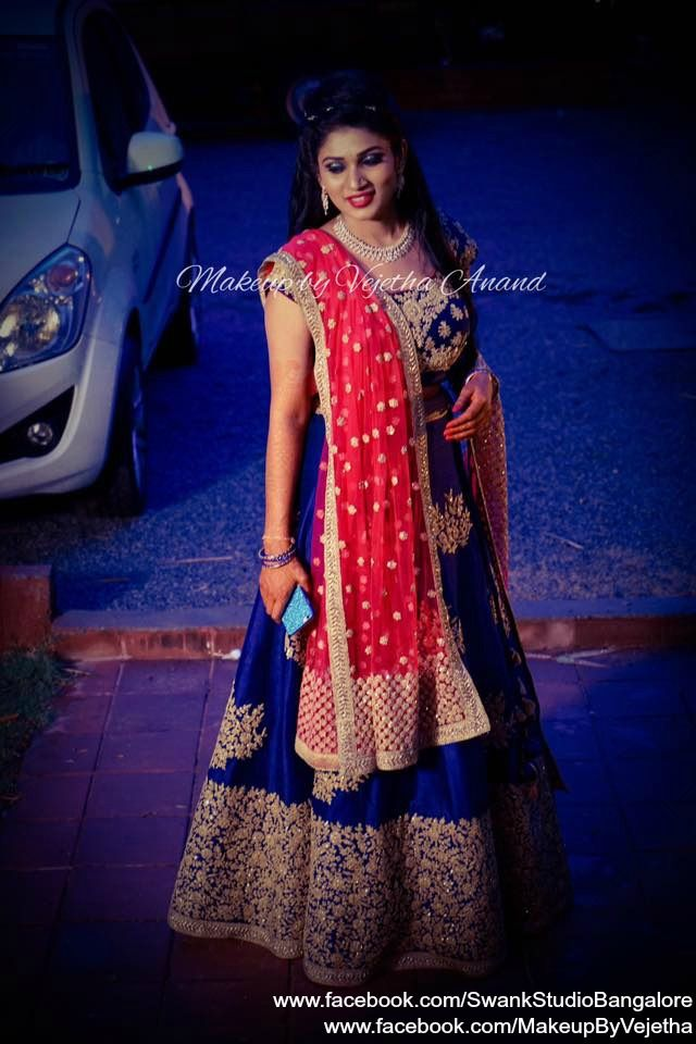 Our would-be bride Pavithra looks stunning for her Sangeet ceremony in that gorgeous blue, red and gold bridal lehenga. Makeup and hairstyle by Vejetha for Swank Studio. Photo credit: Manish Ananda Coral lips. Lehenga love. Designer lehenga. Bridal hairstyle. Indian Bridal Makeup. Indian Bride. Gold Jewellery. Statement Blouse. Tamil bride. Telugu bride. Kannada bride. Hindu bride. Malayalee bride. Find us at https://www.facebook.com/SwankStudioBangalore