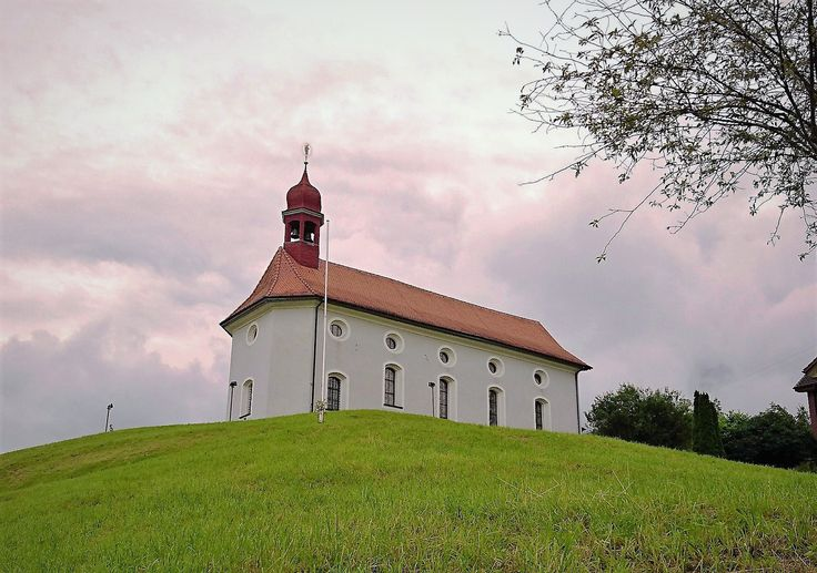 Church sitting perfectly on the hill in Beckenried, Switzerland.