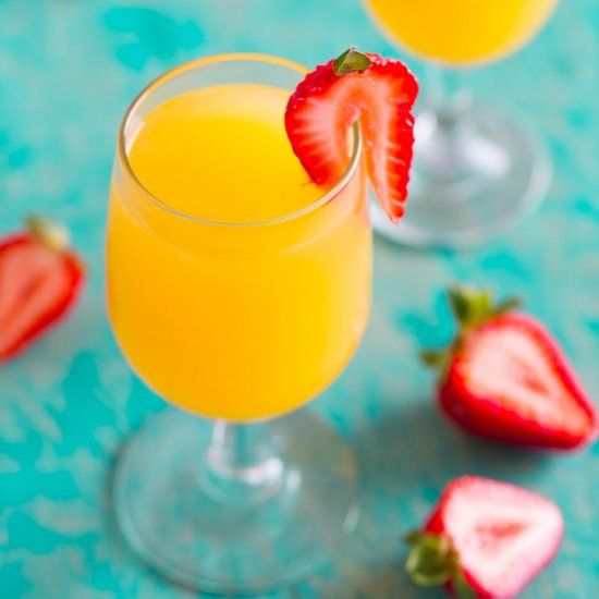 Tropical Mango Mimosas - A fun, easy, and refreshing twist on classic mimosas! A party favorite and everyone will want a REFILL!