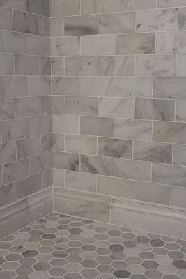hexagon subway grey Floor tiles in shower. Greyish marbale for walls.