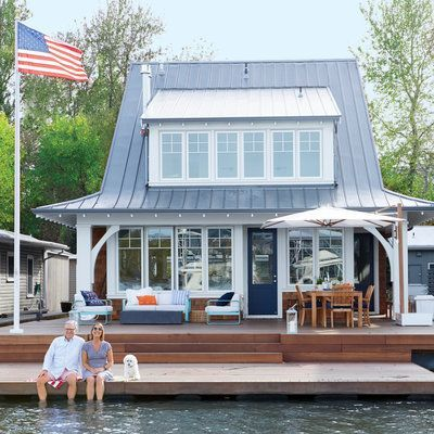 Pictured: The two-story floating home sits in a slip along the Willamette River, with a red balau deck that doubles as a boat launch for kayaks and paddleboards.