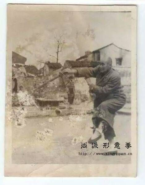 Old picture of a xing yi quan boxer training with the jian (Chinese straight sword).