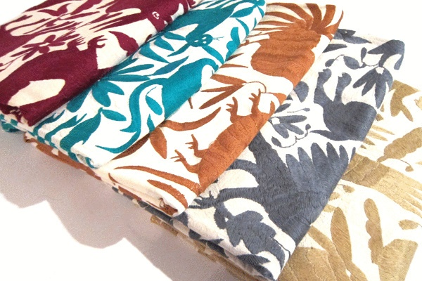 Mexican Coverlet - Embroirdered by the Otomi Indians in Hidalgo, the colorful bedspreads will look great spread out on a bed, over a sofa, or underneath you on the beach or at a picnic. Sourced by FATHOM contributor and globetrotting tastemaker Laura Aviva. $325Beach House, Pattern, Fabrics Prints, Chairs Cushions, Otomi Fabrics, Mexicans Otomi, Prints Colors, Otomi Pillows, Otomi Textiles
