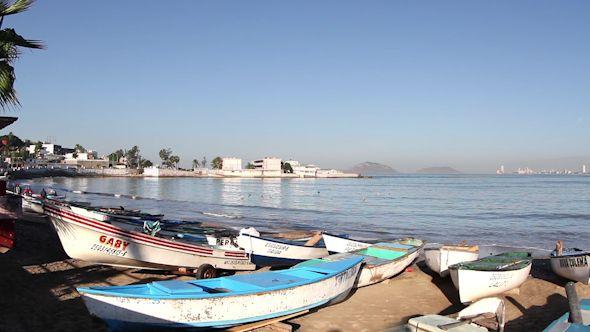 Fishing Boats At Sunrise Mazatlan Mexico 1 by dubassy Fishing boats on the beach in mazatlan, mexico.