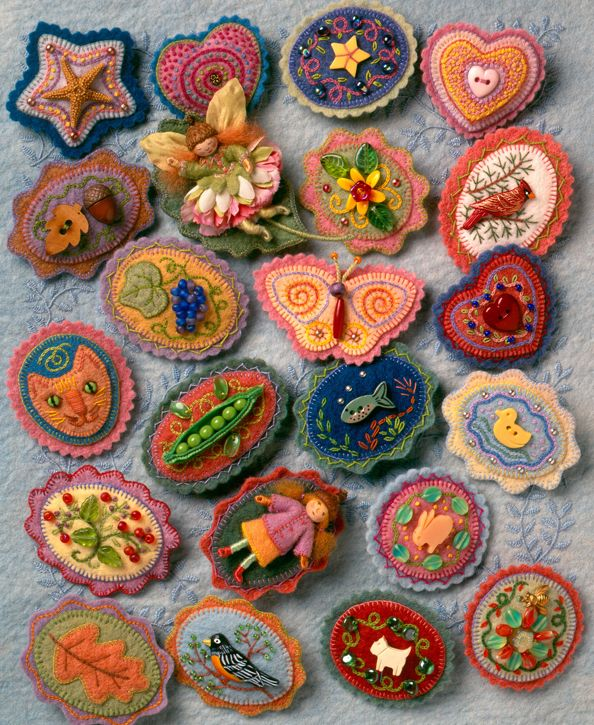 Beautiful little felt brooches. I will never be patient enough for embroidery like this, but I love all the little details.