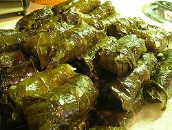 http://low-cholesterol.food.com/recipe/dolma-stuffed-grape-leaves-198071 - I've never seen tomato paste in dolmas before, but this is something I might tinker with. Then again, maybe I could use a more familiar recipe & substitute tempeh for the ground lamb?