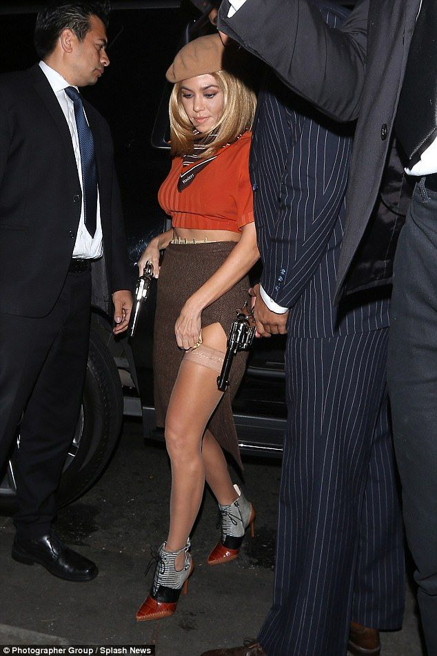 Going all out: Kourtney completed the look with a shoulder-length blonde wig, a nude coloured beret, as well as a pair of stylish pointed heels