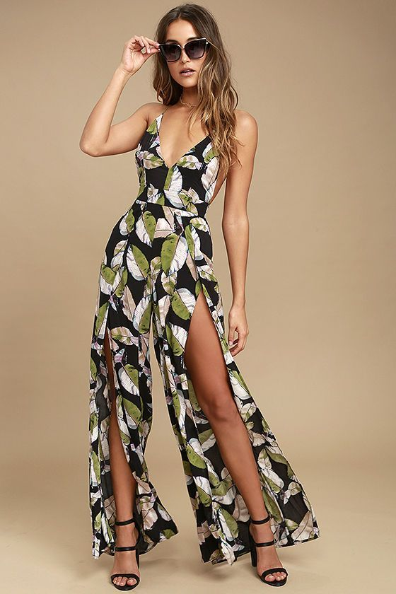 Put on your floppy hat and enjoy the day in the San Tropez Black Print Jumpsuit! Breezy woven rayon in a green, white, blue, and purple leaf print falls from skinny straps that crisscross and tie at back, into a darted, triangle bodice. Banded waist tops high-waisted trousers with wide, tulip legs. Elasticized open back with hidden zipper.