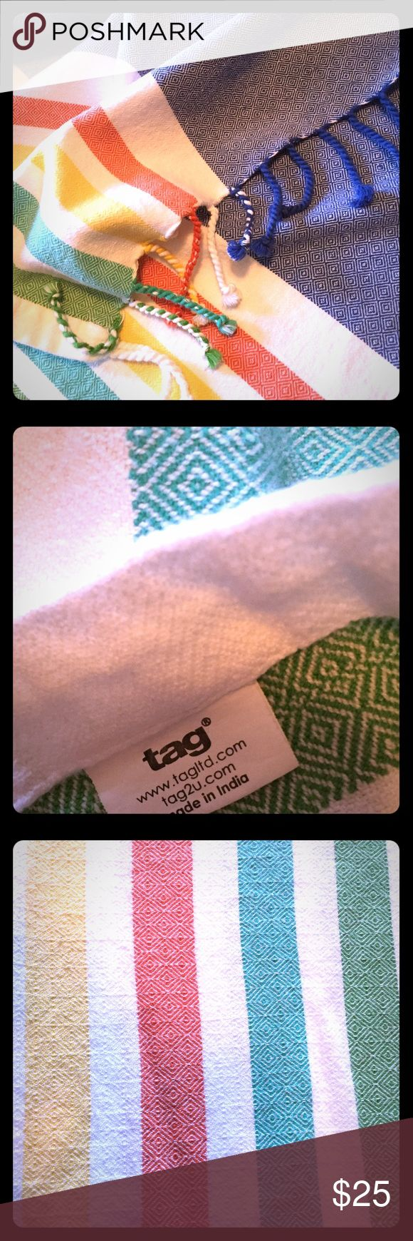 Tag Multi-Color Tablecloth Beach styling, bright, soft, fun! This Tag tablecloth is rectangular and fits tables seating 6-8. Barely used, bright whites and colors! Perfect summer tablecloth - goes well with beach-themed tablewear. Tag Other