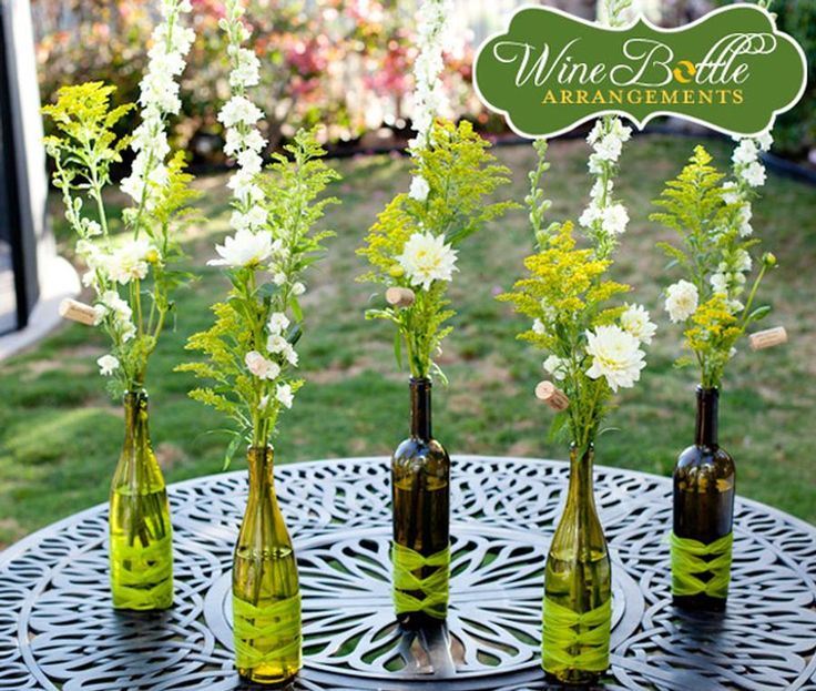 Wine bottle vases and lovely flowers. Great for outdoor dinner or wine /cheese party.