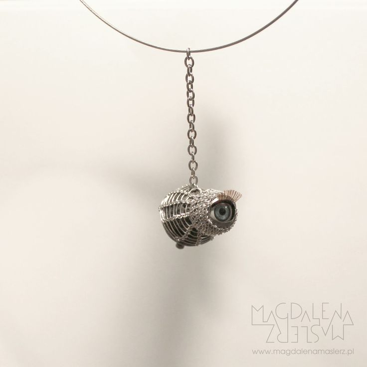 magdalena maślerz - a pendant with artificial eye (winks at you!), lava ball, part of the watch, silver coated wire and jeweler string. 2011